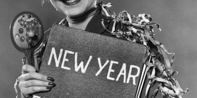 woman holding a new year resolution sign